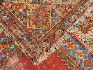 Late 18th century Mujur in distressed condition, but with stunning colour. 69in by 53in