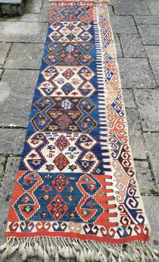 Late 19th century Aksaray kelim panel in good condition, strong natural dyes 112in by 29in  Minor nick in border