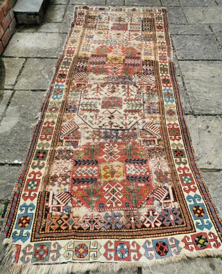 Very distressed mid 19th century Akstafa longrug with chajli design Good saturated colours, but definitely a restoration project or study piece, it's had quite enough foot-traffic already... 107in by 43in