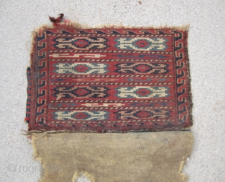 Turkoman..... knotted , small Yomud bag.....Late 19th C......vegetal dyes .....complete w/ back....condition as shown.....