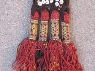 """Balouch Talisman...early 20th C.....8"""" x 30"""" (20cm x 76cm ) madder and aniline dyed threads...plaited goat-hair, with cowrie shells & glass(?) buttons."""