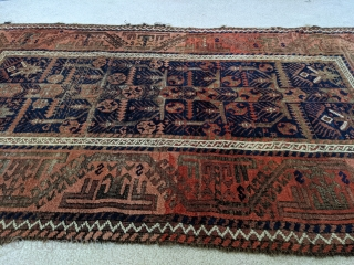 Stunning antique Baluch. 5ft 6in x 3ft 1in. Real unique center panel design. High soft wool except the corroded brown areas. Great colors.