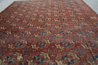 Beautiful 3rd quarter 19th century Tekke main rug. 8ft x 6ft 6in. Unusual minor border and gul. Mostly low pile, one square patch was removed, two tears on one end, and one  ...