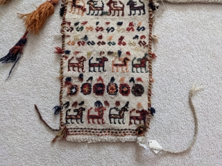 Early 1900s. Qashqai horse blanket or cover. 4ft7in x 5ft. Wonderful repeating animal figures with a few silk braids woven in here and there. A few scattered small holes but overall great  ...