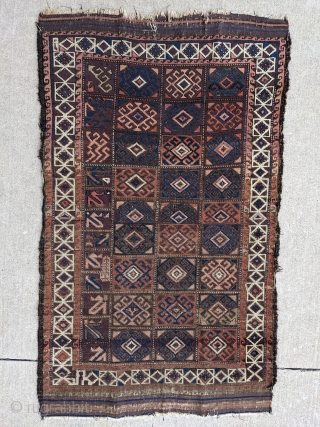 Archaic looking Baluch with incredible range of colors. Look at that main panel on the right!  Maybe a student practice piece or some kind of script?  3ft 11in x 2ft  ...