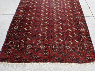 """19th Century Tekke rug with rare, older elem design. 4ft x 5'2"""". Wonderful, deep madder red with dark and light blues. Both elems have a different pattern. 2/3rds full pile and the  ..."""