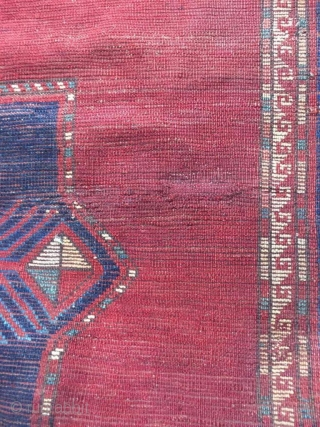 Antique Kazak rug. Beautiful open field with great greens and light blues. Good medium pile throughout. Dated. One old repair which is barely visible from the front.  Cheers.