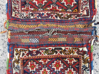 Antique qashqai saddlebag in perfect condition,with gezel geychi pattern as qashqai's call it,Size:110x52 cm,and a nice back kilim