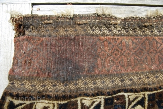 Old Baluch/Timuri bag face, 87 x 94 cm, traces of use, could need a wash; at top an unusual broad finely woven strip, at bottom a narrow one