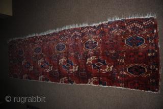 Antique Tekke main carpet fragment, 65 x 228 cm, condition issues, moth bites