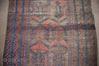 Antique Baluch rug with a design of large flowers (blossoms), 114 x 182 cm, wear, thin, fragmentary