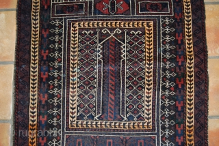 Old Baluch prayer rug, 88 x 142 cm, one professionally made repair and one possible not natural colour and two small green stains