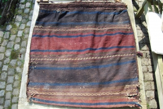 Old Baluch bag, complete with woven back and original woodden grips,some damage at the lower corners and the back, but full pile otherwise, finely woven closures at top, 85 x 83 cm,  ...