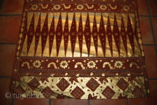Old batik from Indonesia (Java), 190 x 100 cm, additionally decorated on one side with golden colour, rather good condition
