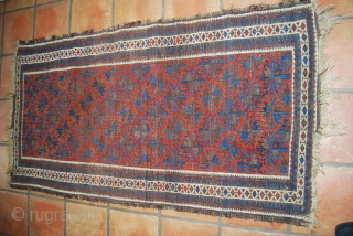 Old Baluch rug, 83 x 159 cm, traces of use, oxidation (brown), small losses at top and bottom