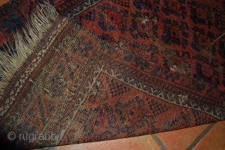 Old Baluch prayer rug fragment, 85 x 133 cm, right side reduced (8 cm), holes, tears
