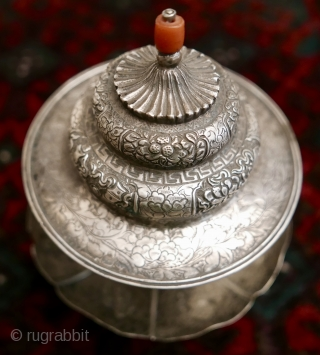 18th-19th c Tibetan silver teacup holder (dkar yol yu),  lid (kha leb)and cup (phor pa) with very finely chased and repousse-worked Buddhist auspicious symbols and a splayed lotus fineal surmounted by  ...