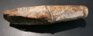 Fossilized walrus tusk fragment fashioned into a 'chopping tool'(adz) by Inuit(Eskimo) people; recovered from village midden on St Lawrence Island in the Bering Sea.  Approximately 4000 years old.  Fantastic patina.  ...