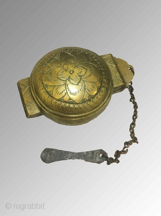 A pair of early 20th century round brass boxes from Sri Lanka (Ceylon), which were collected in Indonesia. Including an attached chain and flattened spatula was used to hold and carry lime  ...