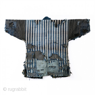 A tattered and stunning Japanese boro work jacket, or noragi. 