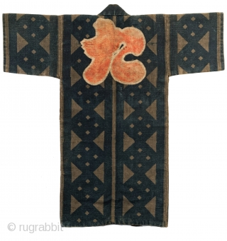 This is a striking antique Japanese fireman's jacket - hikeshi banten. The coat is made from multiple layers of cotton held together with upwards of 100 stitches per square inch.