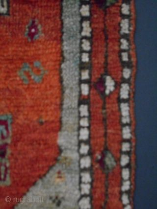 "Central Anatolian yastic, good age, with the primitive qualities one would expect in a genuine tribal weaving, size 16"" x 39"" (+/-), the red used to accent the guls is cochineal, full  ..."