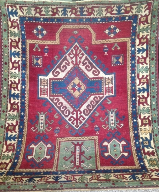 Unique Fahrola Kazak, with rare design and borders.the size 4x4'11 ( 122x150 cm)