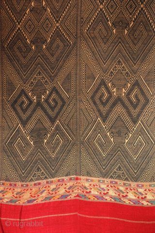 """A rare and wonderful early cotton/silk Tai Daeng tribal textile with ancestral & protective figures. Indigo dyed handspun cotton brocade with silk border. Laos, early 1900s excellent condition  75"""" x 36"""""""