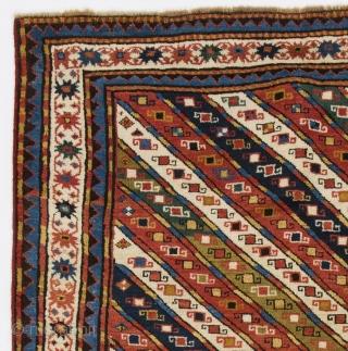 Antique Caucasian Karabagh Kazak Rug with colorful diagonal stripes.  4.6x7.1 Ft (138x217 cm, inventory no: 4324). Ca late 19th Century, good original condition.