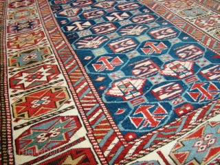 Sweet little Caucasian rug in great shape. All original with braided ends intact.