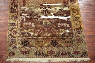 """Antique Turkish long rug. Floppy handle like a thin blanket. All the old unfinished re-piled areas are on the original foundation. Knots are asymmetrical open to left.   Size: 5'3""""X11'5"""""""
