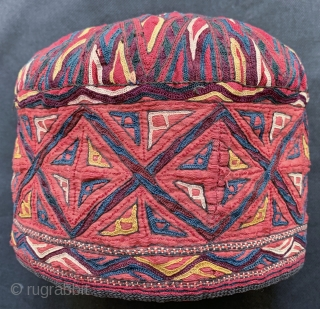 An rare antique Turkoman / Turkmen silk embroidered on silk bridal hat attributed to the Tekke / Teke tribe. Dating to the 19th century, this brilliant textile was an integral part of  ...