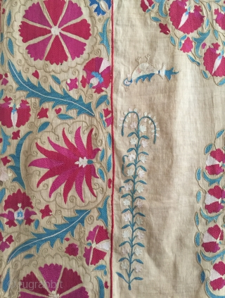 An exceptional antique Uzbek Nurata silk suzani fragment dating to the mid 19th century. The fine silk embroidery is intricately flat-stitched and chain-stitched on a very fine hand woven linen ground. The  ...