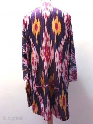 A beautiful antique Uzbek Bukhara silk warp & weft Shahi Ikat women's summer shirt  dating to last quarter of 19th century. We often see Ikat robes or hangings but a nice  ...