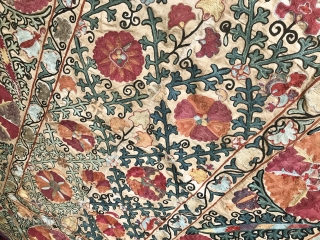 An beautiful Antique Uzbek Bokhara Suzani / Susani dating to the 19th Century. It is fine silk embroidery on Karbos (hand woven cotton) fabric using a chain stitched technique. The lattice floral  ...