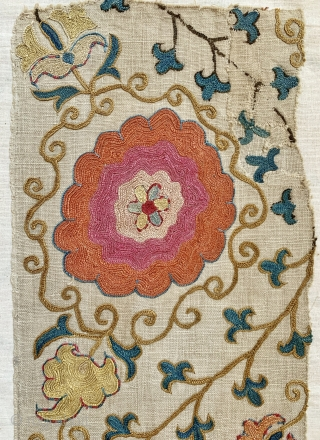 An outstanding  antique Uzbek Bukhara silk suzani fragment (stitched on a canvas ready to be mounted) dating to the mid 19th century. The embroidery is exceptional chain-stitched silk on karbos ground.  ...