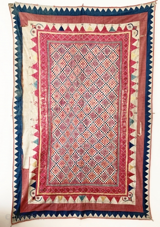 A gorgeous antique Indian silk embroidered and appliquéd wall or tent hanging from Gujarat. It dates around early 1900s and it is a visual delight. The field is made of floss silk  ...