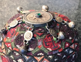 A rare complete antique silk embroidered Yomud / Yomut tribe Turkoman / Turkmen young man / boy's hat with original gold appliqué on silver  talismanic crown. There is a distinctive beauty  ...