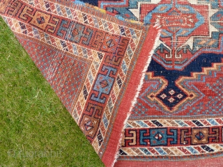 "An interesting Afshar rug with three Turkmen guls. Worn but attractive. All good colours, late 19th Century. 5'6"" x 4'4"" / 168 x 130 cm."