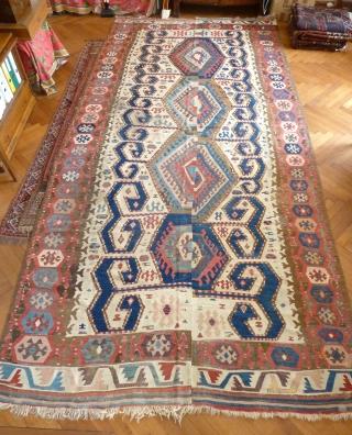 "An early 19th century Central Anatolian kilim with wondrous colours. 390 x 195 cm / 12'10"" x 6'5""."