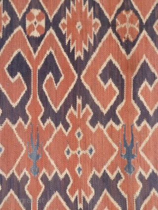 A Toraja Sulawesi ceremonial cloth, joined cotton lengths in warp ikat technique. Indonesia, mid 20th Century. Note the human figures interspersed between the geometric motifs.