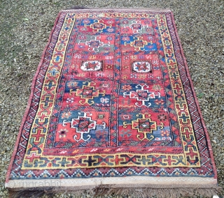 A good early 20th Century Quchan Kurd rug, North East Persia. 225x137cm. In very good original condition, except for a small area of worn pile (see detail).