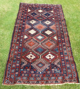 A striking Kurdish rug in good condition and with all natural colours, 220 x 130cm.
