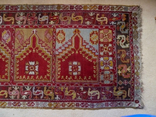 A charming central Anatolian prayer saph, c.1900, with a typically vivid palette. 320 x 103 cm. It is in very good condition, with a little loss at one end, a small bite  ...