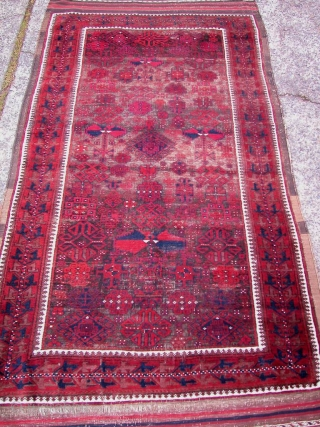 """Baluch, 19th century. All natural dyes. 4'1"""" x 7'9"""". Corroded brown field, otherwise excellent condition."""