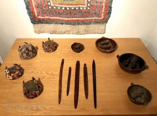 Pre-Columbian weaving tools.  Chancay and Wari culture. Weaving swords and bobbins with carved human and animal figures. Longest implement is a highly unusual Wari bobbin with a standing figure that is  ...