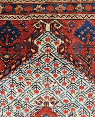 19th century Beshir prayer rug with a white ground mihrab that features clusters of stylized pomegranates. These prayer rugs are found in several different variants or groups as delineated by Ralph Kaffel  ...