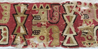 Exquisitely woven Pre-Columbian Wari headband. A.D. 600 - 800.  Damaged, but a complete weaving with ends intact and selvedges in evidence. The design shows profile heads with headdresses and stylized wing  ...