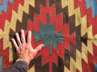 Anatolian Kilim. First half of the 19th century. Large scale and bold, simple design.  Good color. Complete with 30 year old minor reweaves (done states-side - see detail).  Size: 150  ...