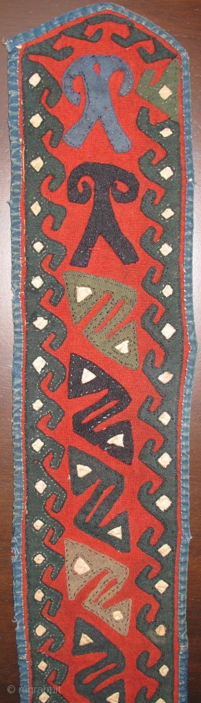 Central Asian Applique Band, red felt-like textile attached to a an old Russian trade cloth attached with indigo dyed cotton binding. Either a belt or perhaps a collar from a garment. Certainly  ...